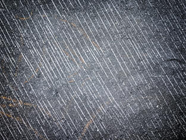 Het patroon van de oude muur met decoratieve gips donkergrijze en zwarte kleuren