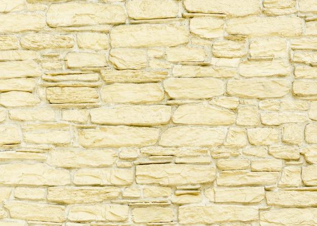 Het patroon van een gebarsten bruine steen