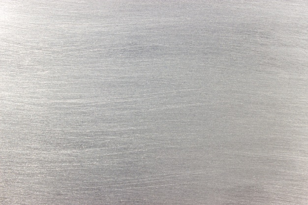 Het patroon van een metalen plaat, lichtgrijze achtergrond