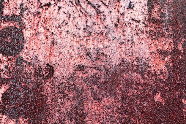 Het patroon van een metalen wand met roest