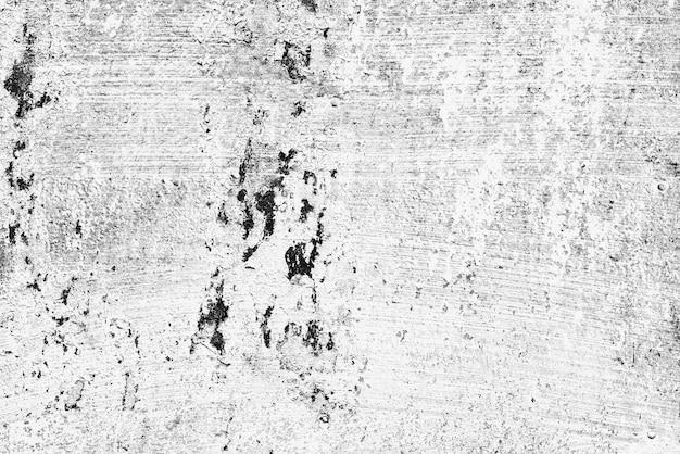 Het patroon van een metalen wand met scheuren en krassen die als achtergrond kunnen worden gebruikt