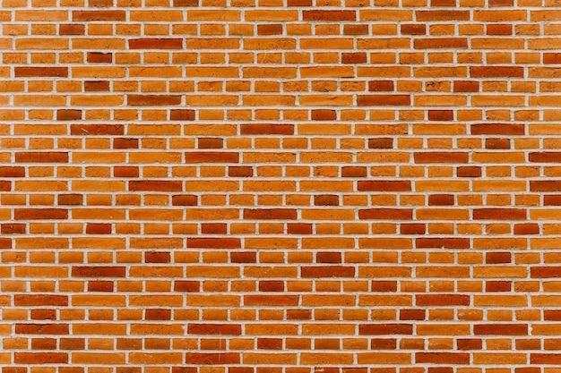 Het patroon van een nieuwe bakstenen muur