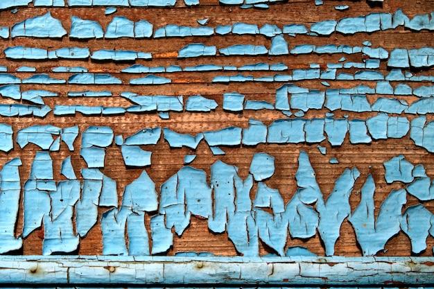 Het patroon van een oude houten muur met gepelde blauwe verf abstracte achtergrond.