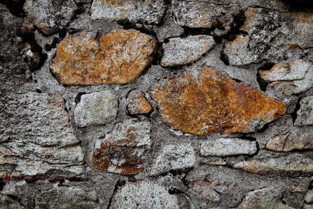 Het patroon van een stenen muur oude stenen muur textuur achtergrond stenen muur als achtergrond of textuur deel van een stenen muur voor achtergrond of textuur