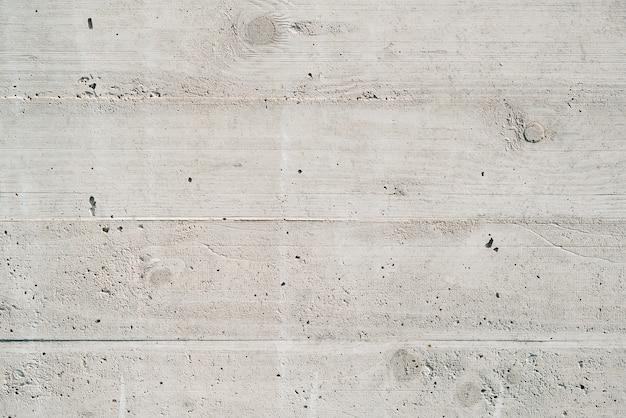 Het patroon van gepleisterde kolommen. oude grijze betonnen muur.