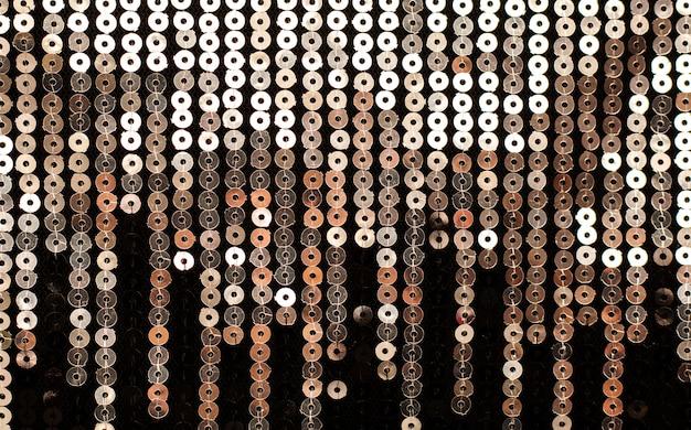 Het patroon van gouden pailletten