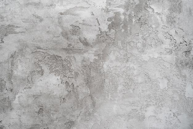 Het patroon van grijze gips op een witte muur