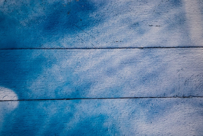 Het patroon van oude gebarsten verf op houten planken.