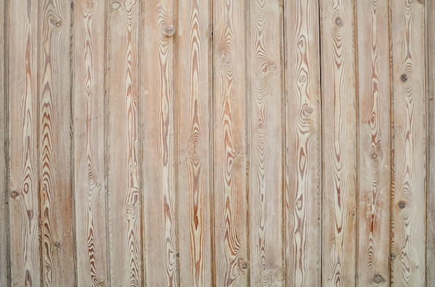 Het patroon van smalle lichte houten planken met aders en knopen.