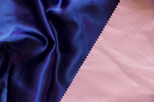 Het patroontextiel van strepen op vlotte blauwe doek