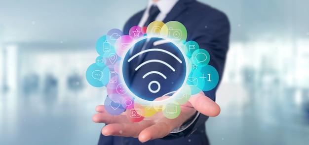 Het pictogram van wifi van de zakenmanholding het omringen door colorfull sociale media pictogram het 3d teruggeven