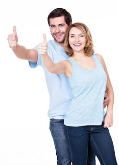 Het portret van het gelukkige paar met duimen ondertekent omhoog geïsoleerd