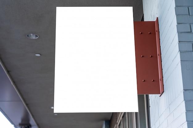 Het rechthoekige witte concept van het bedrijfsteken op een bakstenen muur