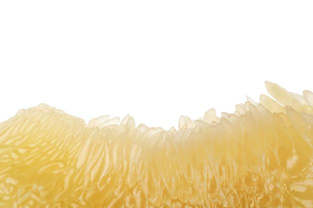 Het rijpe die pompelmoesfruit op witte achtergrond wordt geïsoleerd, sluit omhoog