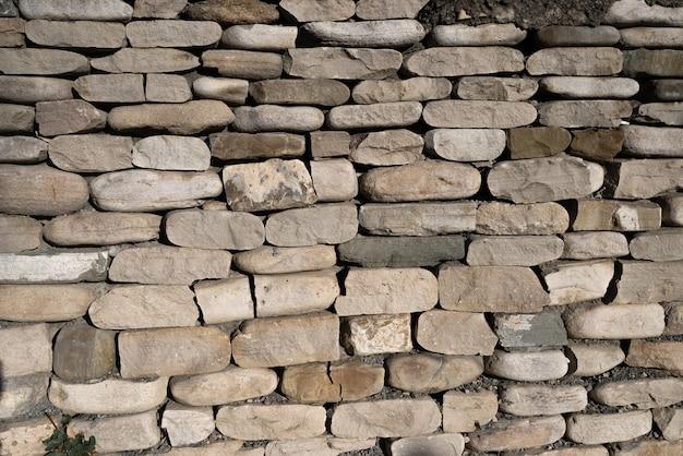 Het ritme van vele stenen die op elkaar liggen. achtergrond