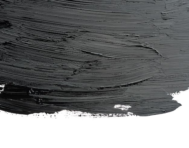 Het staal van zwarte vlekkerige acrylverf die op witte achtergrond wordt geïsoleerd, sluit omhoog