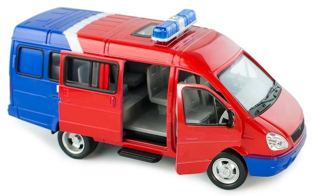 Het stuk speelgoed van kinderen plastic politiewagen met geïsoleerd op wit