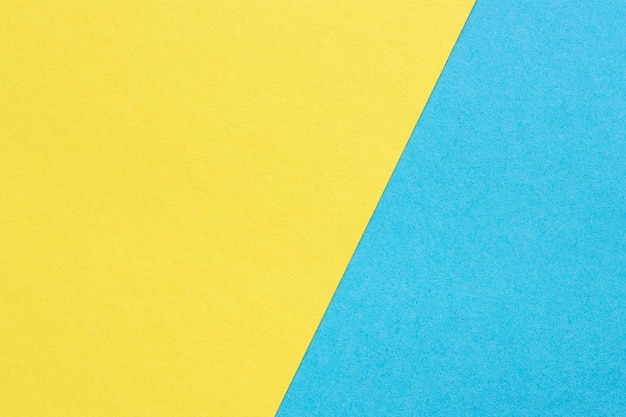 Het textuur zware document, vat gele en blauwe achtergrond samen