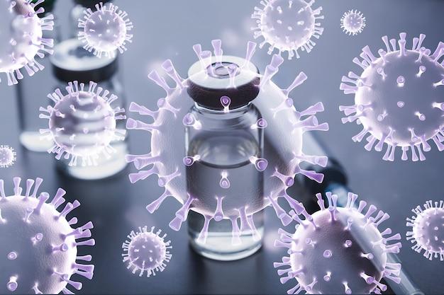 Het vaccin in een glazen buisje met een spuit op tafel met een afbeelding van bacteriën