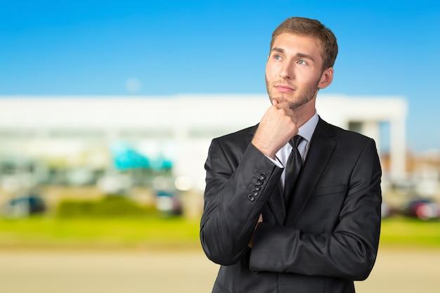 Het verwarde jonge zakenman denken