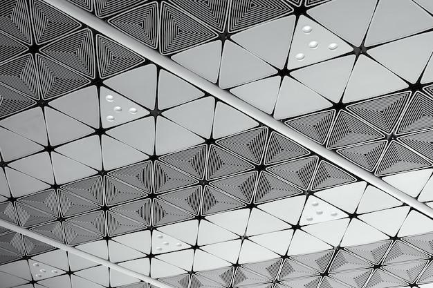 Het witte plafond met neonlichtbollen uprisen binnen mening als achtergrondbinnenhuisarchitectuur