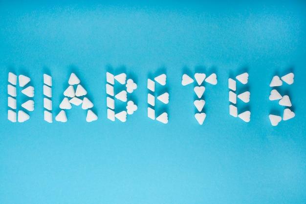 Het woord diabetes wordt geschreven in suikerklontjes.
