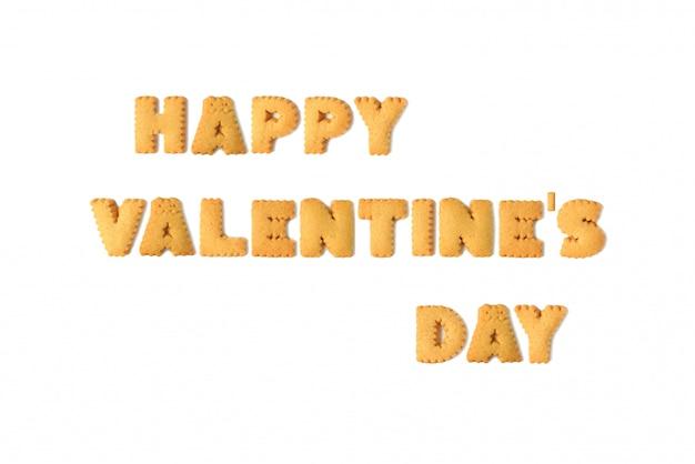 Het woord gelukkige valentijnsdag gespeld met geïsoleerde alfabetkoekjes