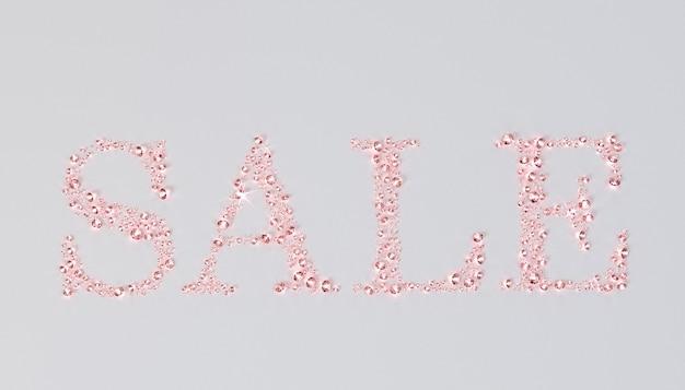 Het woord sale is bekleed met roze diamanten