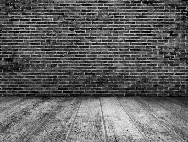 Het zwart-witte binnenland van de grungeruimte met bakstenen muurachtergrond
