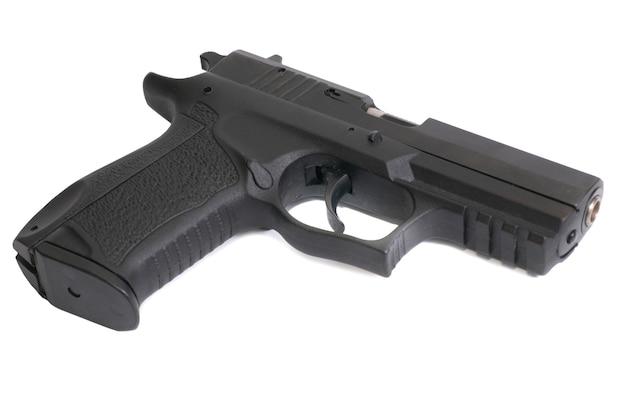 Het zwarte pistool geïsoleerd op een witte achtergrond