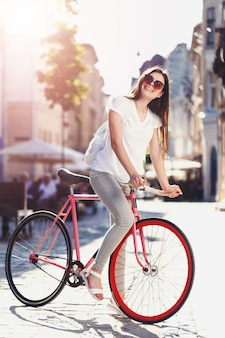 Hipster girl ride bicycle