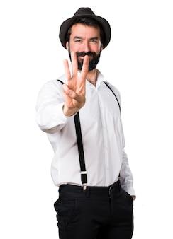 Hipster man met baard tellen drie
