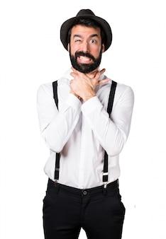 Hipster man met baard verdrinkt zichzelf