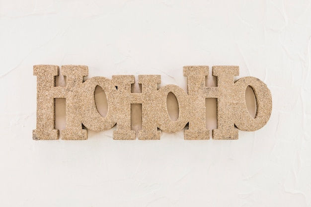 Ho ho ho-inscriptie op een witte plaat