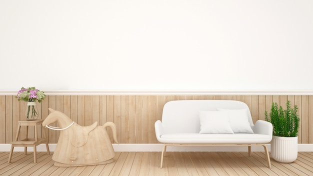 Hobbelpaard en sofa in de kinderkamer in de kwekerij - interior design