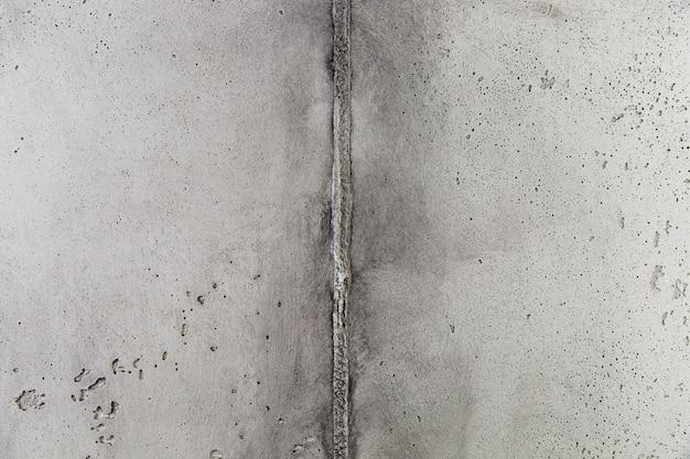 Hoek van betonnen muur met ruw oppervlak