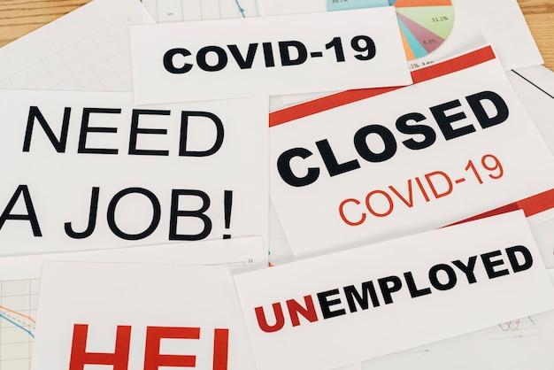 Hoge hoek covid19 en werkloosheidstekens