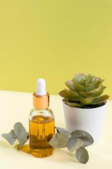 Hoge hoek serumfles met plant