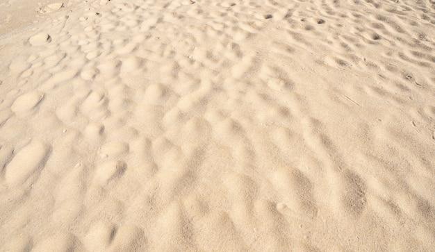 Hoge kwaliteit detail van zand textuur achtergrond bovenaanzicht. prachtige natuur en reisachtergrond.
