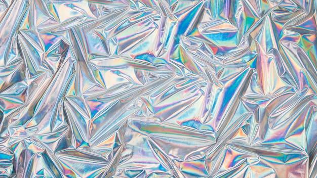 Holografische iriserende oppervlak gerimpelde dampgolfachtergrond. trendy ontwerptextuur