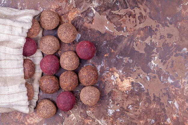 Homemade raw vegan cacao energy balls in craft textile bag