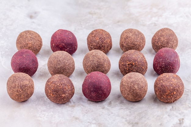Homemade raw vegan cacao energy balls lie in row