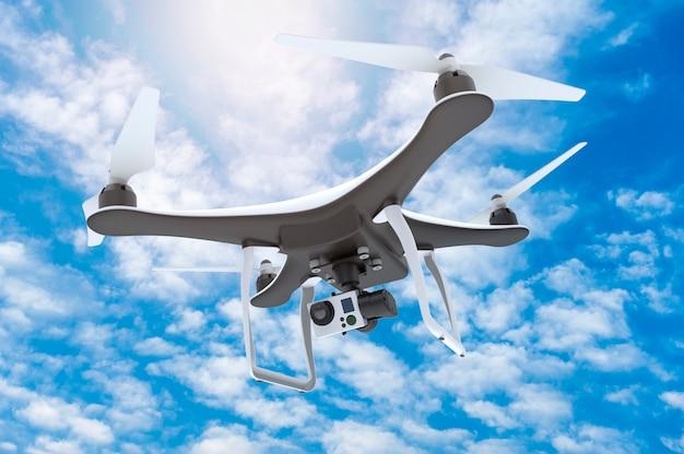 Hommel met digitale camera die op een blauwe hemel vliegt