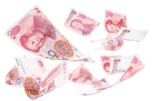 Honderd yuan bankbiljetten vallen samen, renminbi of rmb, chinees geld, vallen, invasie van de chinese economie