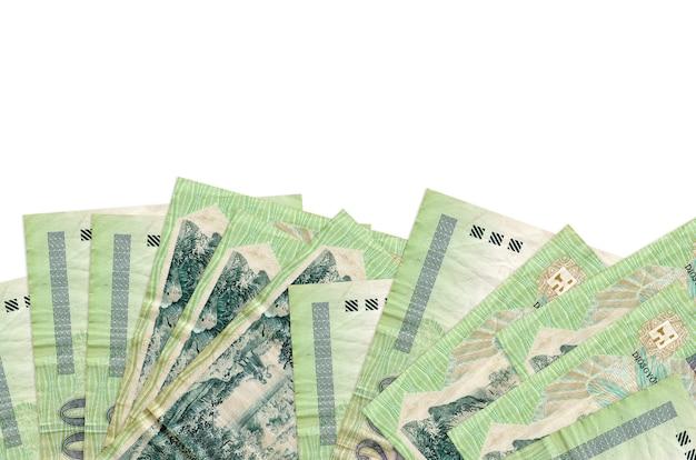 Hongaarse forintbiljetten liggen aan de onderkant van het scherm op wit wordt geïsoleerd