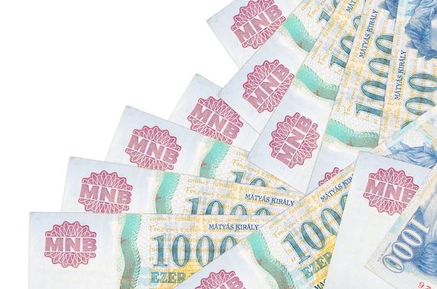 Hongaarse forintrekeningen die in verschillende volgorde op een witte ondergrond leggen