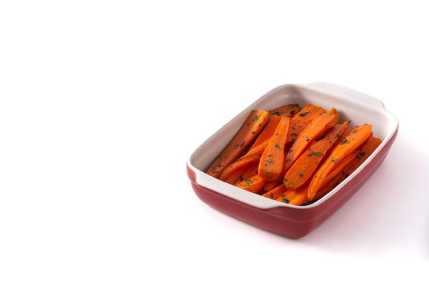 Honing geglazuurde wortelen geïsoleerd op wit