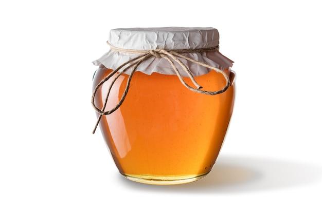 Honing in pot geïsoleerd op een witte ondergrond.