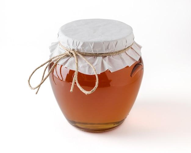 Honing in pot op witte ondergrond.