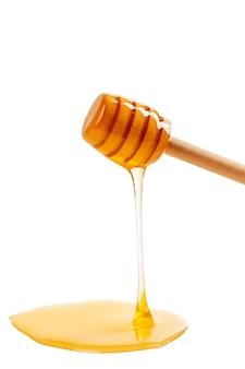 Honing met houten geïsoleerde drizzler